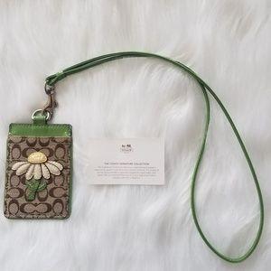Coach Signature ID badge holder in green daisy